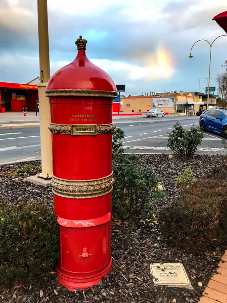 Old style letterbox in Horsham at sunset⁠